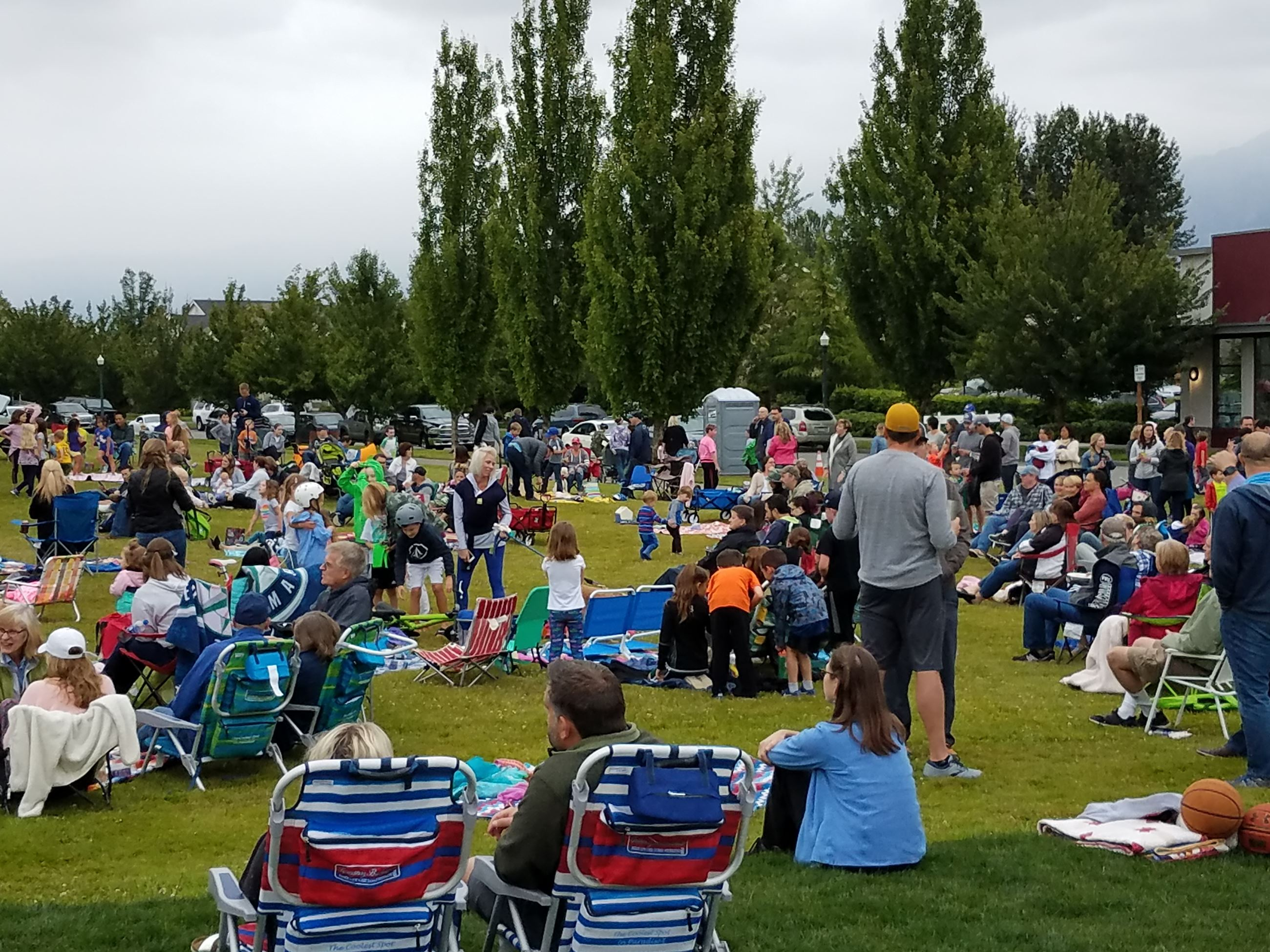 This is a picture of the audience enjoying live music at Snoqualmie Community Park.