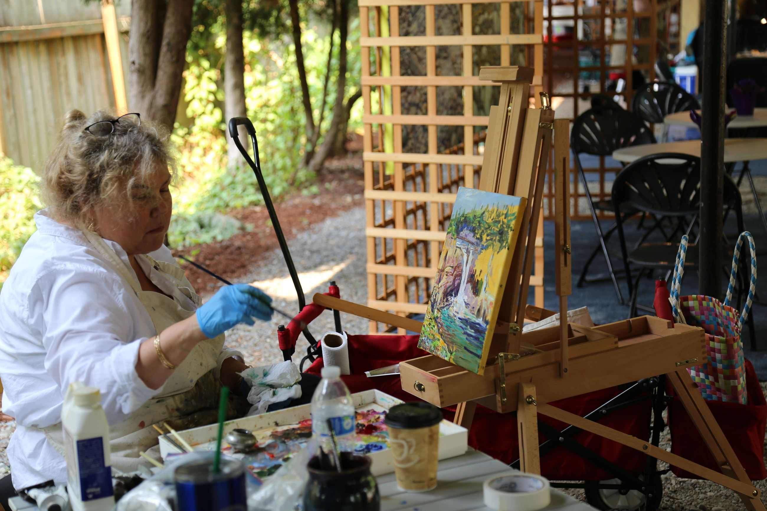 This is a photo of an artist painting during the Snoqualmie Plein Air Paint Out.