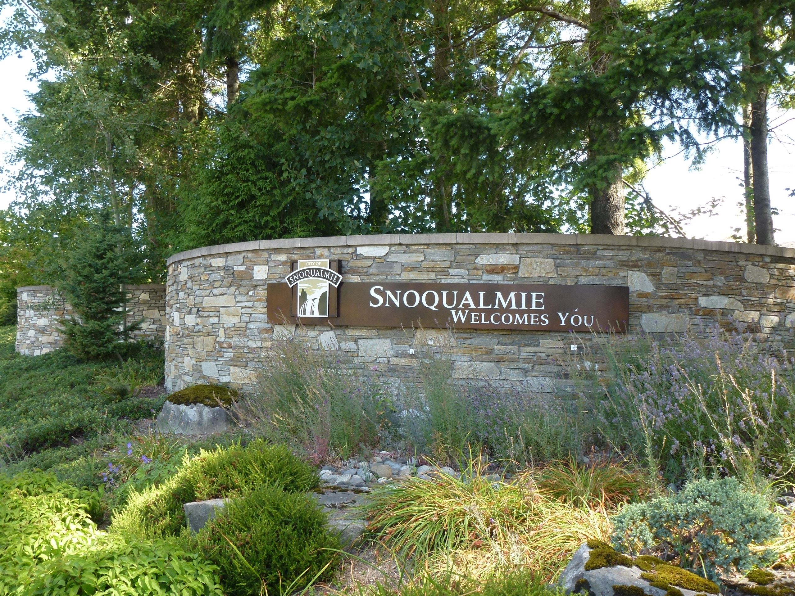 This is a sign that reads Welcome to Snoqualmie.
