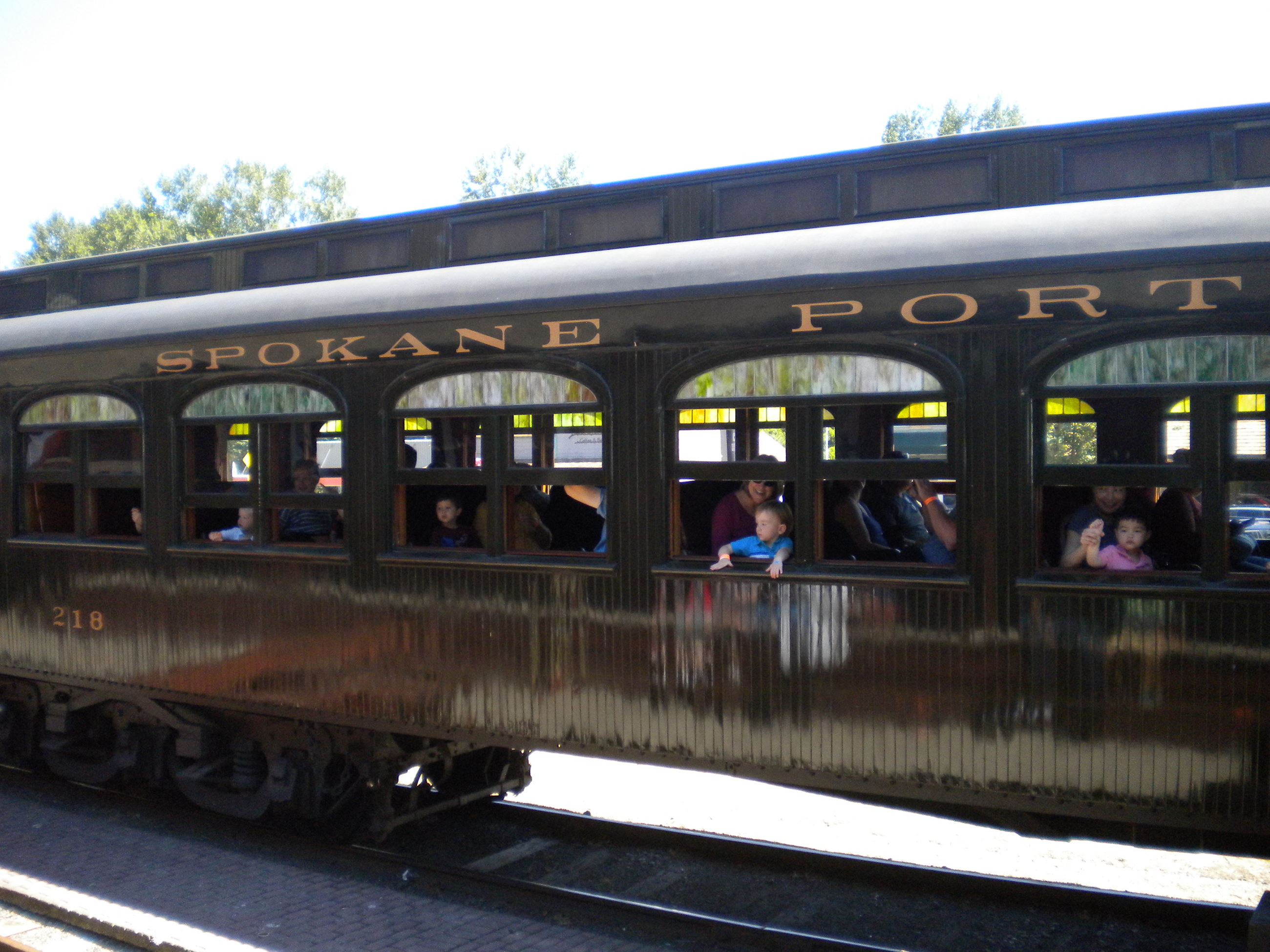 This is a picture of families on a train excursion at the Northwest Railway Museum.