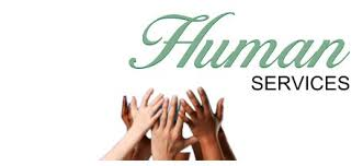 This is an image of hands reaching toward the words human services.